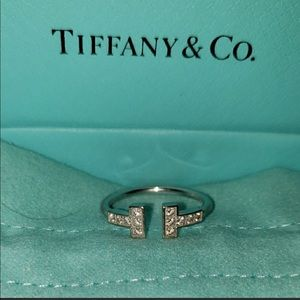 18k white gold and diamond T wire ring.
